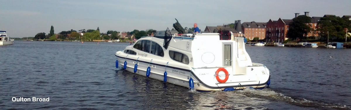 Norfolk Broads hire boat heads out onto Oulton Broad
