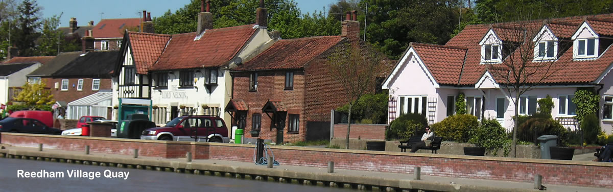 Reedham Village Quay, a popular mooring spot with two Norfolk Broads pubs close-by.