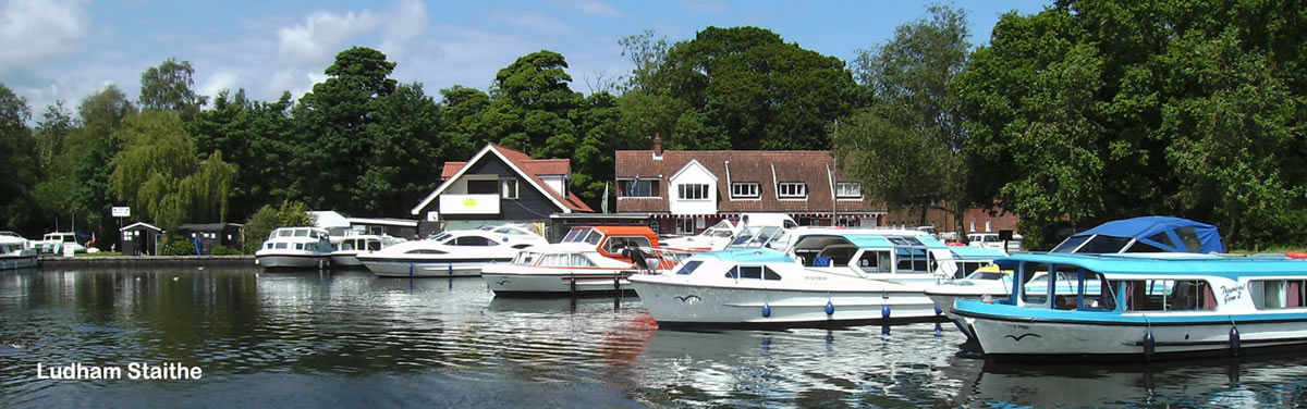 Womack Staithe on the Norfolk Broads with hire boats moored